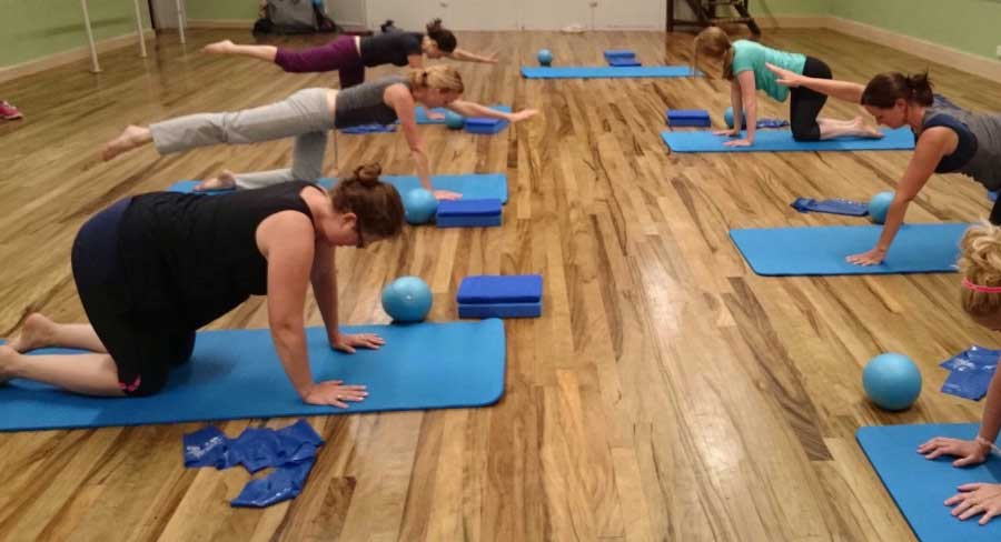 Group of women balancing